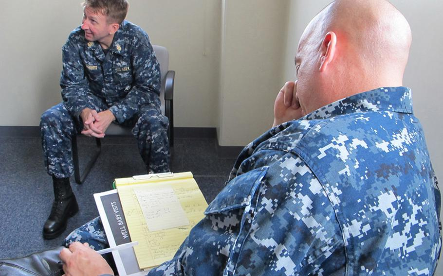 Chief Petty Officer Michael Roberts, head of AFN Sasebo, background, leads a brainstorming session in May 2012 as Petty Officer 2nd Class John Wagner takes notes on ideas for new commercials.