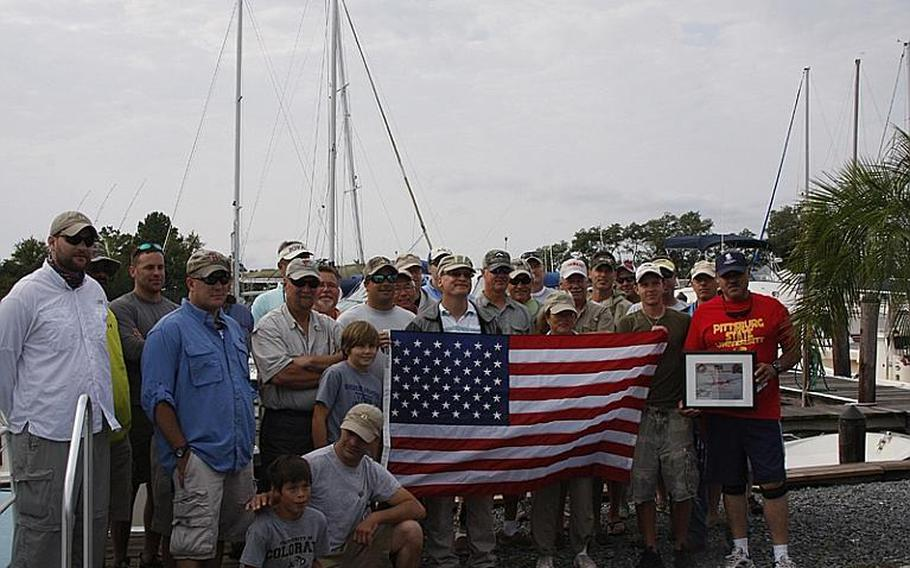 Wounded veterans pose with the fishing boat captains before leaving Dominion Marina in Chester, Md., during last month's Stars and Stripes fishing tournament sponsored by Project Healing Waters. The nonprofit group promotes fishing, typically fly fishing, as therapeutic recreation for wounded veterans.