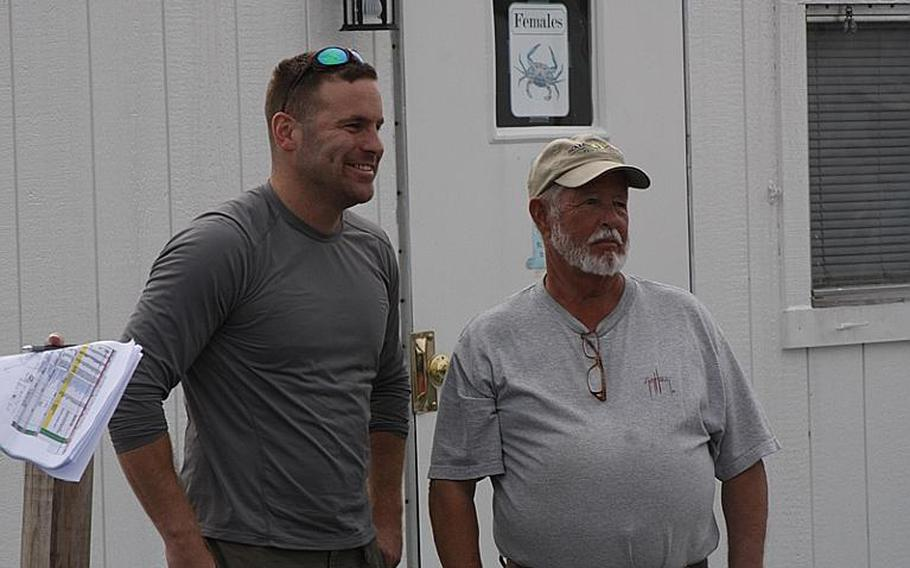 Army Staff Sgt. Robert Bishop, left, poses with his fishing guide, John Rappold, before last month's Stars and Stripers fishing tournament with Project Healing Waters. Bishop is a regular at the group's outings and credits the therapeutic value of fly fishing with helping him address symptoms of post-traumatic stress disorder.