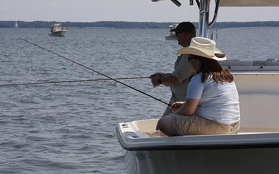 Chris Frost, an Air Force veteran, and his wife, Cathy, an Army veteran, fish during Project Healing Waters' Stars and Stripers tournament last month in Chester, Md.