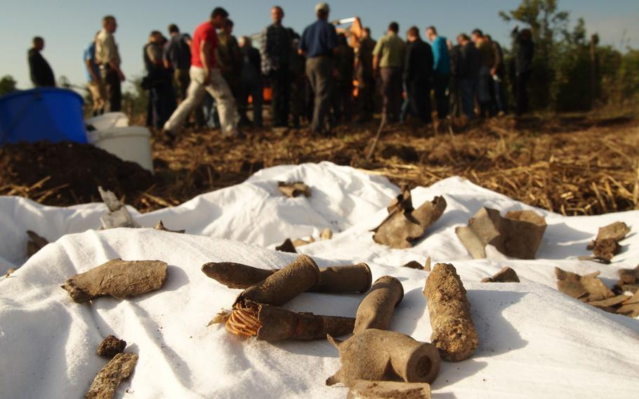 Machine gun ammunition believed to be from a British Lancaster bomber that crashed in Germany in 1943 is laid out on a sheet Saturday as wreckage from the crash site was unearthed by a group of volunteers.