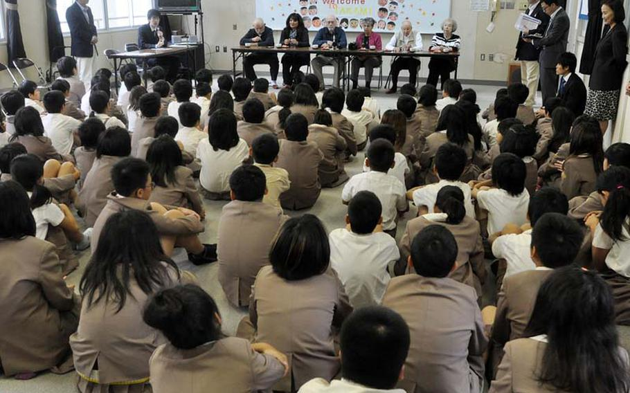 Former POWs George Summers, Bob Ehrhart and Douglas Northam speak to students at Takami Elementary School near where the Sakurajima work camp used to be. The students asked questions about the purpose of war and sang songs celebrating peace.