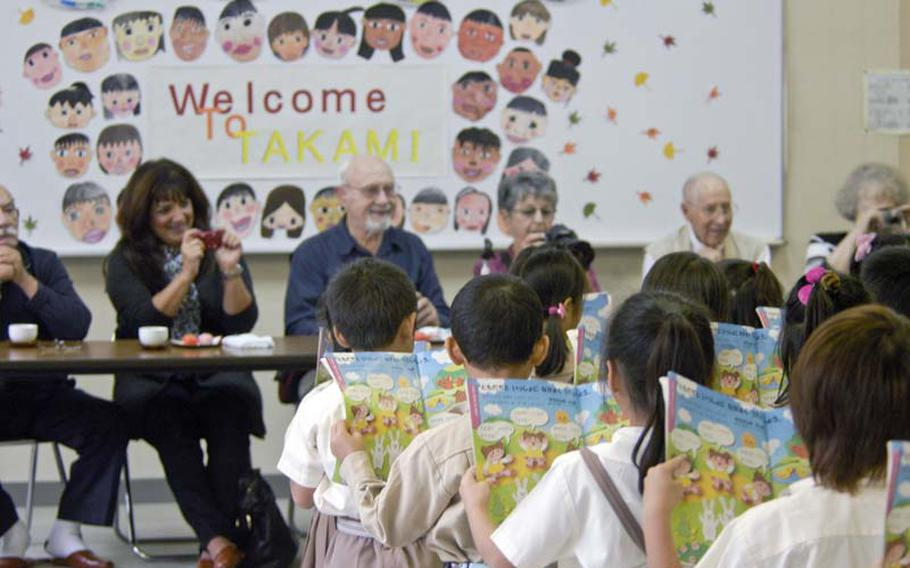 """First-graders from Takami Elementary School in Osaka sing a song for three World War II prisoners of war who came to their school on Oct. 18, 2012. It was one of several stops during a weeklong """"reconciliation tour"""" arranged by the Japanese government to make amends for the brutal treatment the POWs endured while in captivity. This is the third year Japan has funded to the trip for the aging veterans and their families. Before the mini-concert, the men spoke to fifth-graders about their experiences and fielded poignant questions from the children, such as """"Why do we have to have war?"""" The visit concluded with a school lunch served by and eaten alongside the children."""