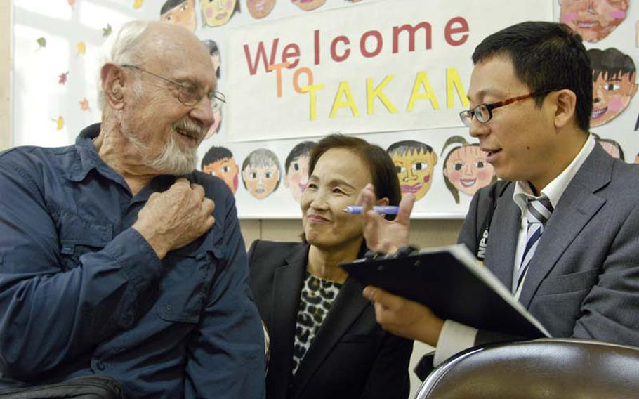 """Bob Ehrhart, 89, far left, tells a Japanese reporter, far right, through translator Kinue Tokudome, center, that he was so moved by the children of Takami Elementary School that it """"brought tears to this Marine's eyes."""""""