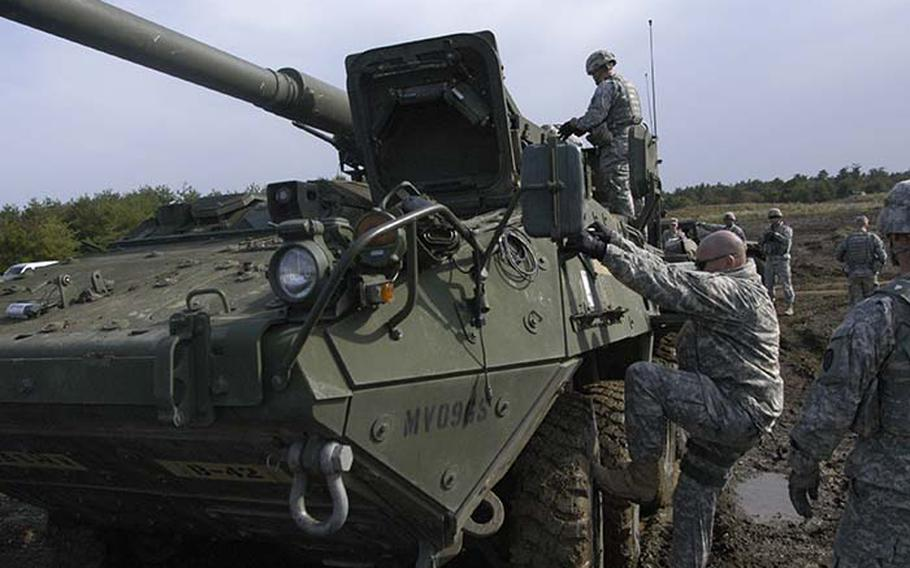 """A U.S. soldier mounts the Stryker Mobile Gun System, a variant of the fast, lightweight Stryker armored troop carrier that has been deployed throughout Iraq and Afghanistan. The MGS, """"has different types of rounds, including a heat round, which will go through a building, a can round, which is an anti-personnel round and a hep round, which will take out a bunker,"""" said 2nd Lt. Robert Villareal, from 1st Battalion, 14th Infantry Regiment, 25th Infantry Division out of Hawaii. """"It's almost like a call for (artillery) fire but it's mobile."""""""