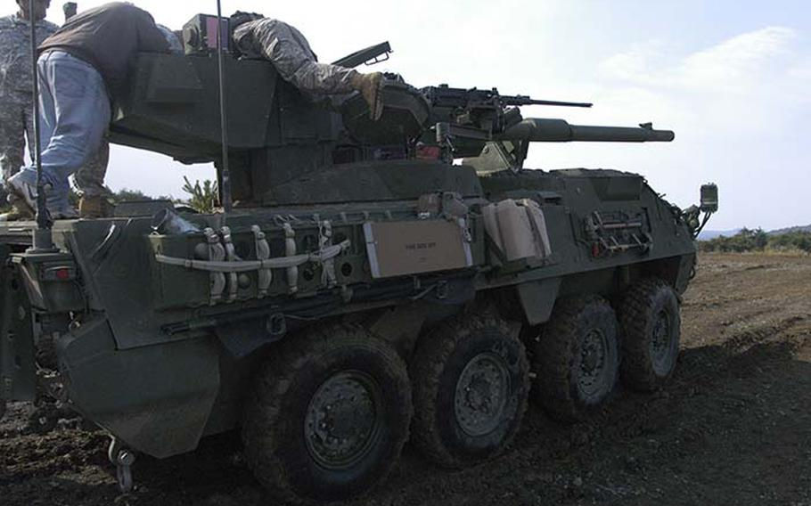 Personnel from 1st Battalion, 14th Infantry Regiment out of Hawaii work on the Stryker Mobile Gun System --- a variant of the fast, lightweight Stryker armored troop carrier that has been deployed throughout Iraq and Afghanistan --- after it malfunctioned Tuesday during a demonstration at exercise Orient Shield.