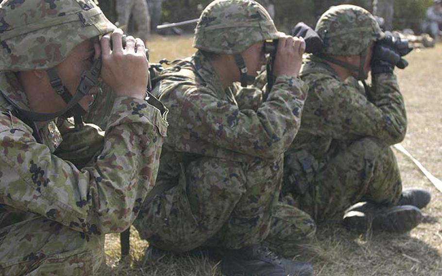 Japanese soldiers from the 33rd Infantry Regiment closely watch a sniper competition Tuesday during exercise Orient Shield. The unit is training alongside 1st Battalion, 14th Infantry Regiment, 25th Infantry Division, out of Hawaii. The 15-day exercise at Aibano Training Area near Kyoto ends Nov. 8.