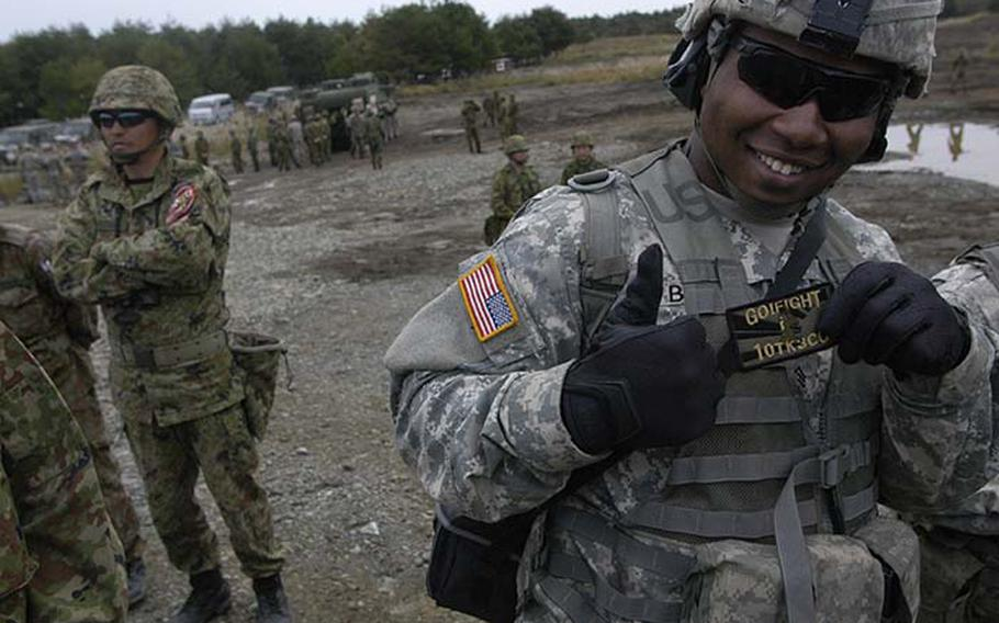 Sgt. DeAndre Bobo, from 1st Battalion, 14th Infantry Regiment out of Hawaii, shows off a patch he received from a Japanese soldier Tuesday during exercise Orient Shield. The 15-day exercise, which ends Nov. 8, focuses not only on training but also camaraderie among the 1,350 American and Japanese soldiers who are participating.