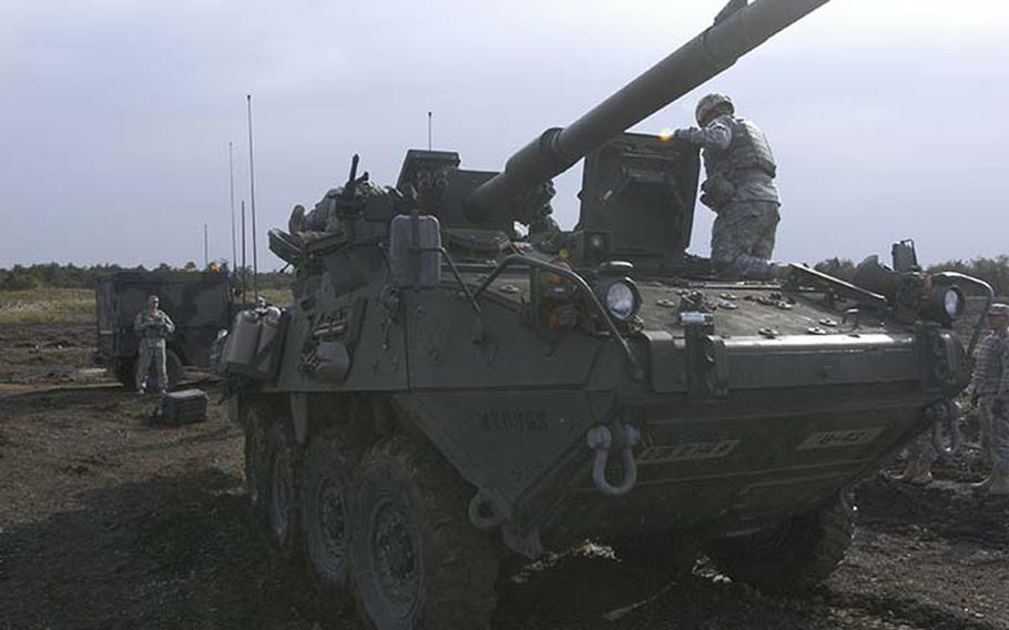 Personnel from 1st Battalion, 14th Infantry Regiment out of Hawaii work on the Stryker Mobile Gun System - a variant of the fast, lightweight Stryker armored troop carrier that has been deployed throughout Iraq and Afghanistan - after it malfunctioned Tuesday during a demonstration at exercise Orient Shield.
