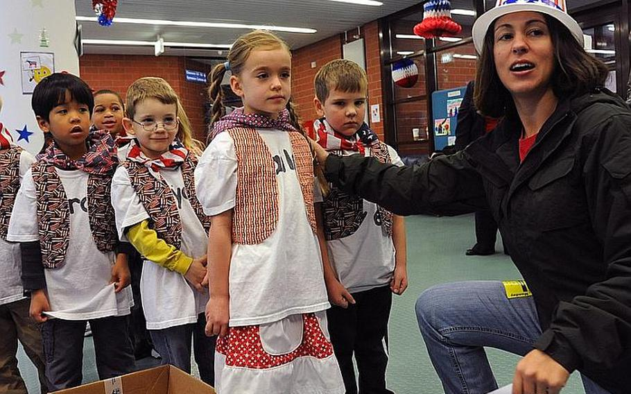 Jessica Lee directs Ramstein Elementary School students to the voting booths during the school's mock presidential election Monday morning.