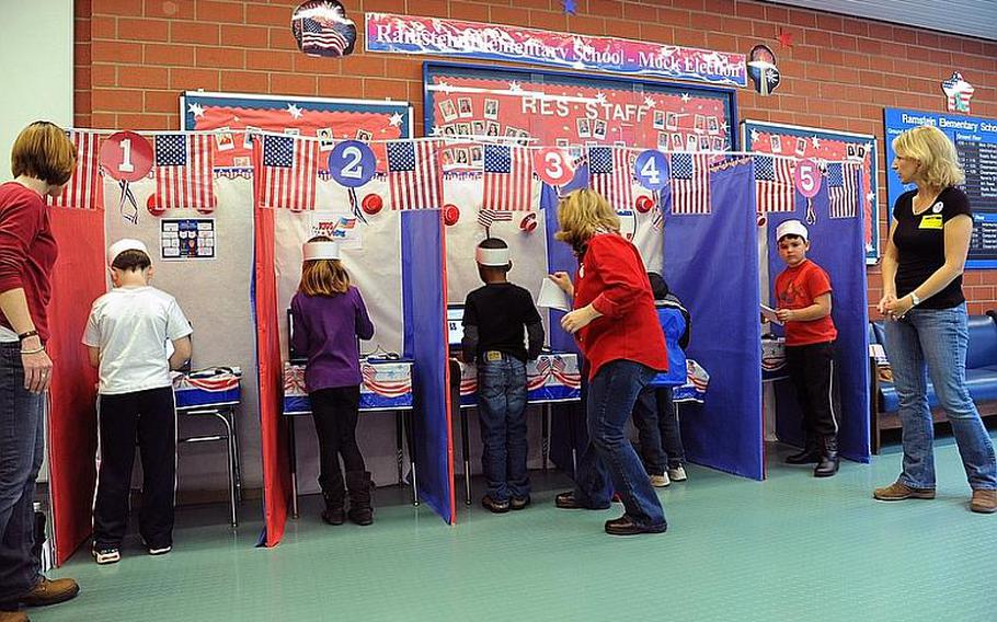 Ramstein Elementary School students vote during the school's mock presidential election Monday morning.