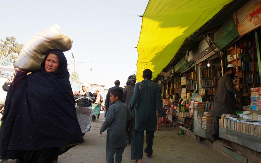 Afghans shop at a Kabul market the day before the U.S. presidential election. Reaction in Afghanistan to the re-election of Barack Obama was mixed, with many Afghans skeptical of American promises after 11 years of war.