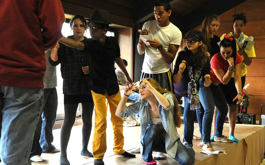 """Members of the drama workshop at the Creative Connections symposium hosted by DODDS-Europe rehearse the one-act play """"Prometheus."""""""