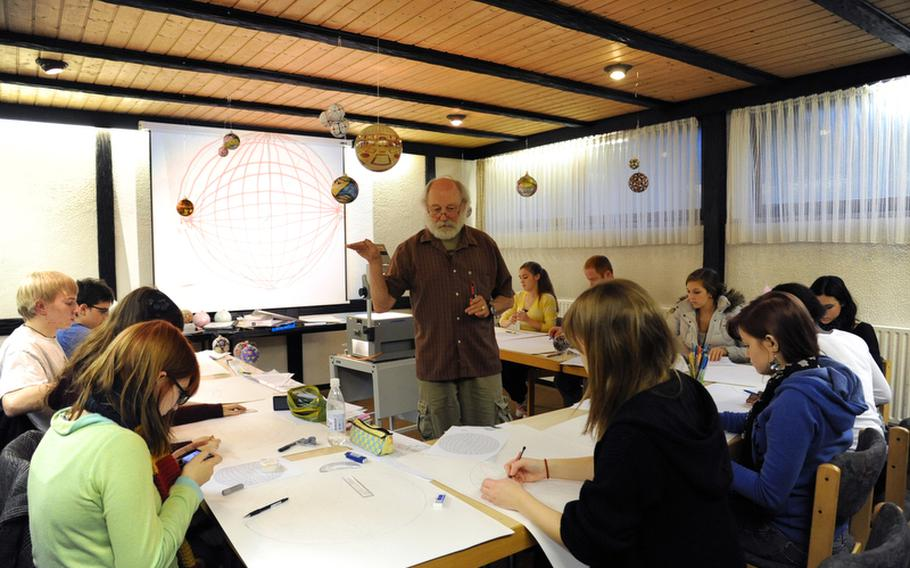 """Instructor Dick Termes gives his students pointers in the """"Spherical Thinking"""" workshop at this year's Creative Connections program for DODDS-Europe high school students."""