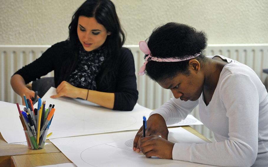 """Alexis Quinones, left, of Rota, and Kiana Gorden of Lakenheath work on their spheres in the """"Spherical Thinking"""" workshop at the Creative Connections  program for DODDS-Europe high school students."""