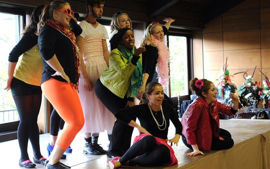 """Members of the show choir rehearse """"Popular"""" from the musical """"Wicked"""" at this year's Creative Connections. There were 157 students from 24 DODDS-Europe high schools participating in 11 visual and performing arts classes at the week-long program."""