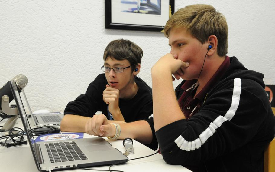 In the video production workshop at Creative Connections, Bitburg junior Kelton Dobbs, left, and Scott Alstiel, a Naples senior, discuss edits on a video the group created.