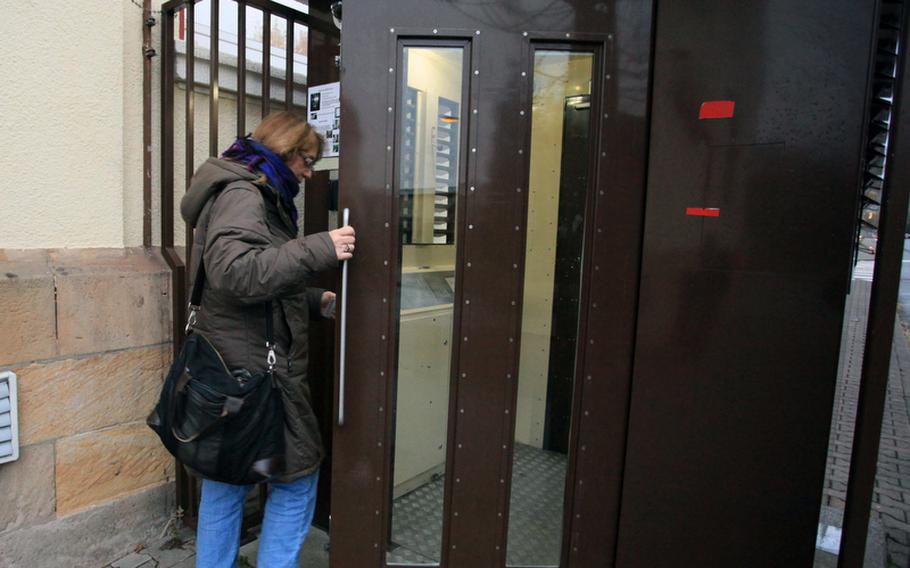 After once getting booted from this automated gate at Kleber Kaserne, Irene Maschke tries again. The gate kicked her out before she even got her finger on its fingerprint reader, the second of two measures the automated system uses for identification to grant or deny entry to the base.