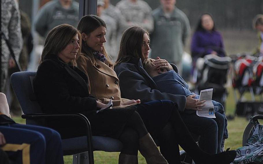 Joyce Voorhees, left, Emily Brainard, center and Corinna Gibson-Ashmead listen as an Army lodging facility is dedicated in memory of Brainard's husband on Urlas Kaserne in Ansbach, Germany, on Friday, Nov. 9, 2012. Capt. John ''Jay'' Brainard was killed in Afghanistan in May. Voorhees is the wife of Col. Jay Voorhees, commander of the 12th Combat Aviation Brigade. Gibson-Ashmead is a surviving military spouse and friend of Emily Brainard.