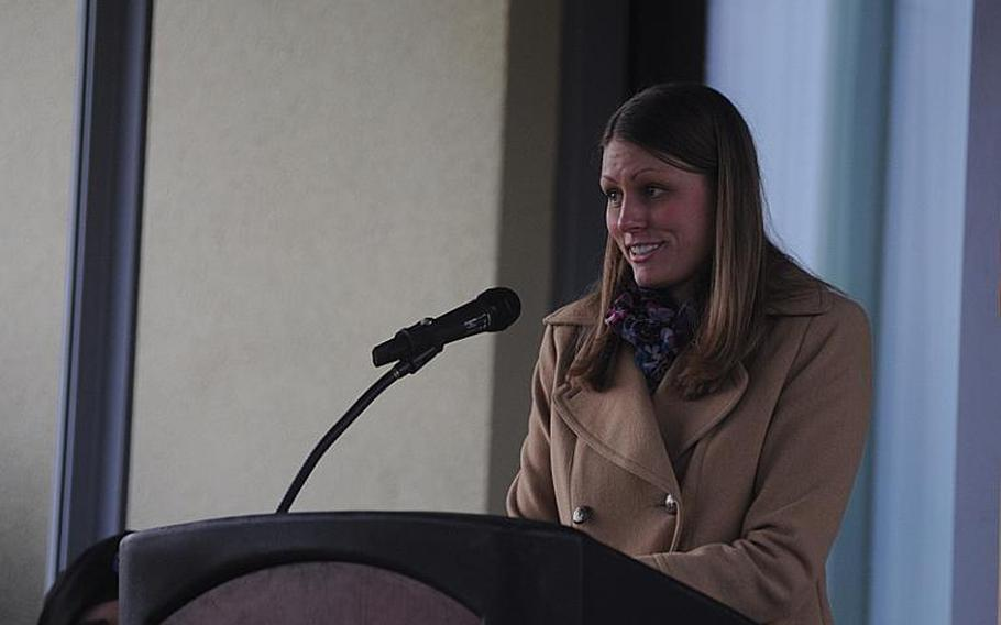 Emily Brainard speaks during the dedication of an Army lodging facility in honor of her husband, Capt. John ''Jay'' Brainard, on Urlas Kaserne in Ansbach, Germany, on Nov. 9, 2012. The captain was killed during a combat flight in Afghanistan in May.