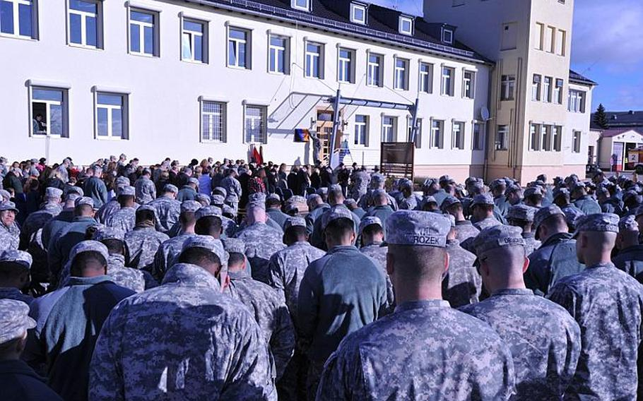 Soldiers from the 12th Combat Aviation Brigade bow their heads during the invocation remembering Chief Warrant Officer 5 John C. Pratt  on Nov. 2 on Katterbach Kaserne in Germany. The brigade headquarters building was renamed Pratt Headquarters in honor of Pratt, who died in May in Afghanistan.