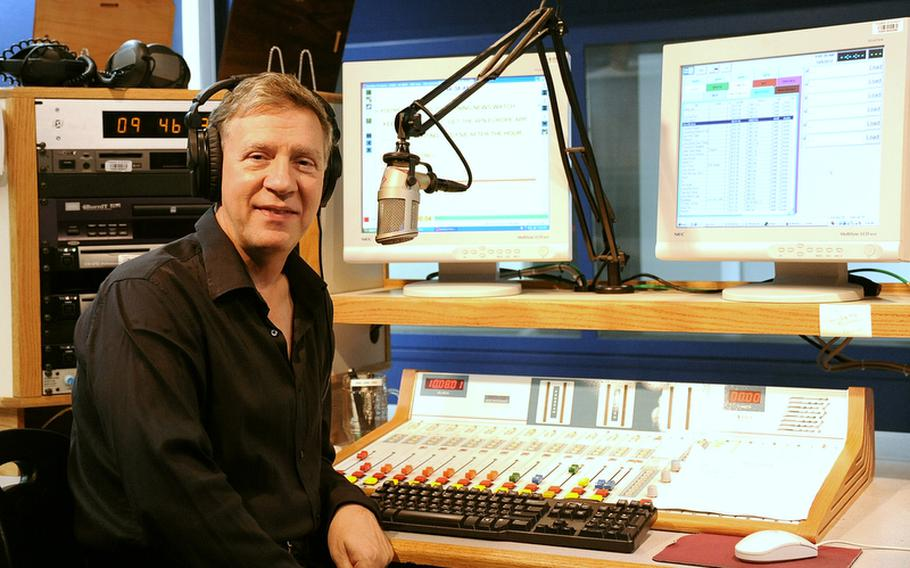 George Smith, 58, posing here in a radio studio at AFN headquarters in Mannheim, Germany, is one of thousands of Defense Department employees overseas who could be affected by stricter guidelines recently issued by DOD making it much more difficult for civilians to extend their overseas tours past five or seven years. Smith has worked in Europe for more than 25 years and currently oversees eight AFN stations in Europe.