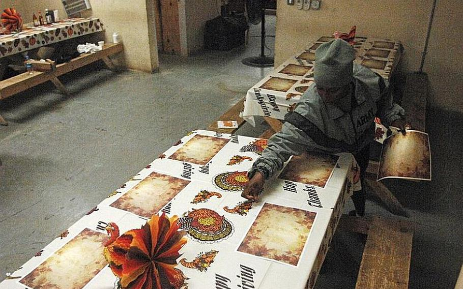 Spc. Shannel Cox, of Brooklyn, N.Y., sets out Thanksgiving Day decorations in the dining facility at Combat Outpost Bawri Tana in Khost province, Afghanistan, Nov. 21, 2012, . For the holiday, soldiers at the outpost were to have turkey, ham and the traditional sides for both lunch and dinner.