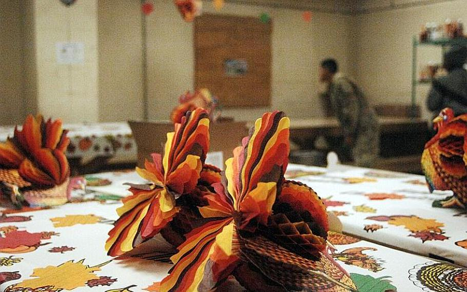 Thanksgiving Day decorations adorn the tables at the dining facility at Combat Outpost Bawri Tana in Khost province, Afghanistan. Soldiers at the outpost were having turkey, ham and the traditional sides for both lunch and dinner on Nov. 22, 2012.