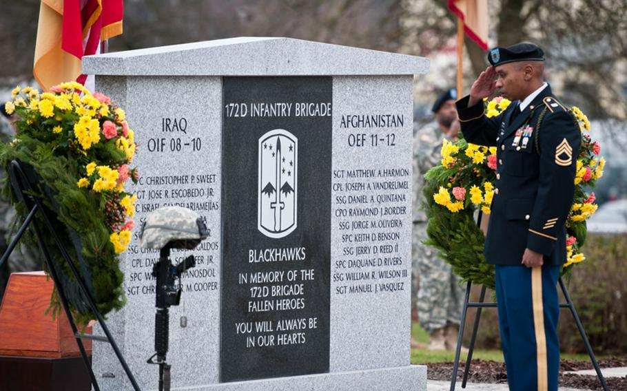 Sgt. First Class Leonado May renders honors after laying a wreath at the 172nd Infantry Brigade memorial monument dedication ceremony on Tuesday. Soldiers from the unit donated more than $12,000 to pay for the construction of the monument. The stone monument is engraved with the names of the 19 fallen service members who were killed in Iraq and Afghanistan while serving with the brigade during its time in Germany.