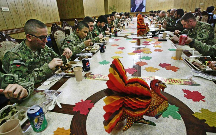 U.S. and Afghan guests take part in the first-ever Thanksgiving dinner celebration at the Kandahar governor's provincial compound in Kandahar City, Afghanistan on November 22, 2012.