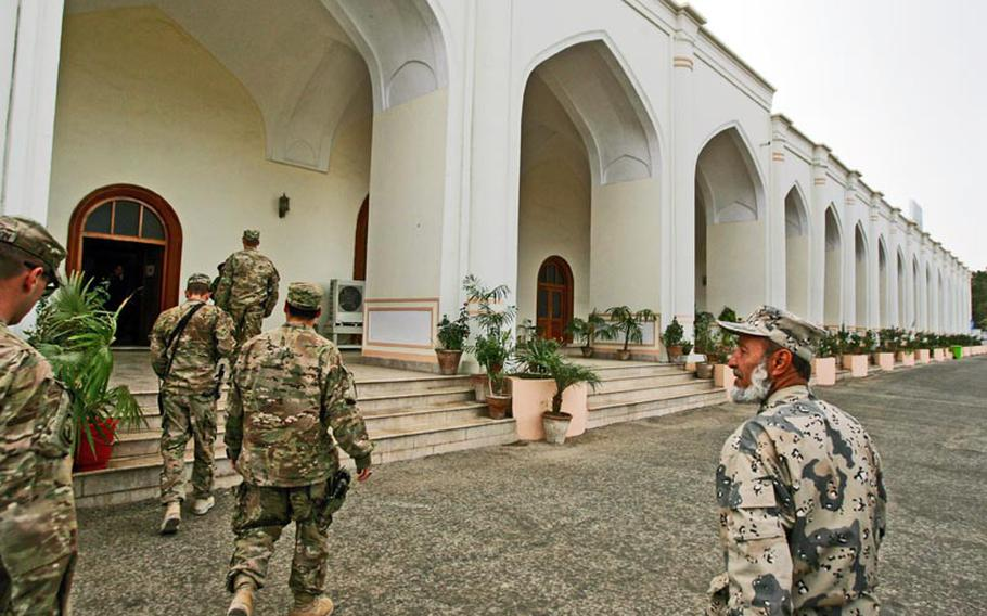 U.S. soldiers and Afghan guests arrive for the first-ever Thanksgiving dinner celebration at the Kandahar governor's provincial compound in Kandahar City, Afghanistan on November 22, 2012.