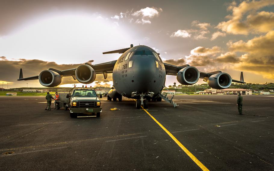 A C-17 sits on the Lajes Field flight line on June 8, 2012. Military operations will be drastically reduced at Lajes as part of larger cost-cutting efforts being made across the Defense Department, the Air Force announced late Thursday. The workforce is expected to shrink, with about 500 families scheduled to leave by the end of fiscal 2014 as the base transitions from an air base wing to an air base group. Airmen assigned there in the future will be on unaccompanied 12 month tours.