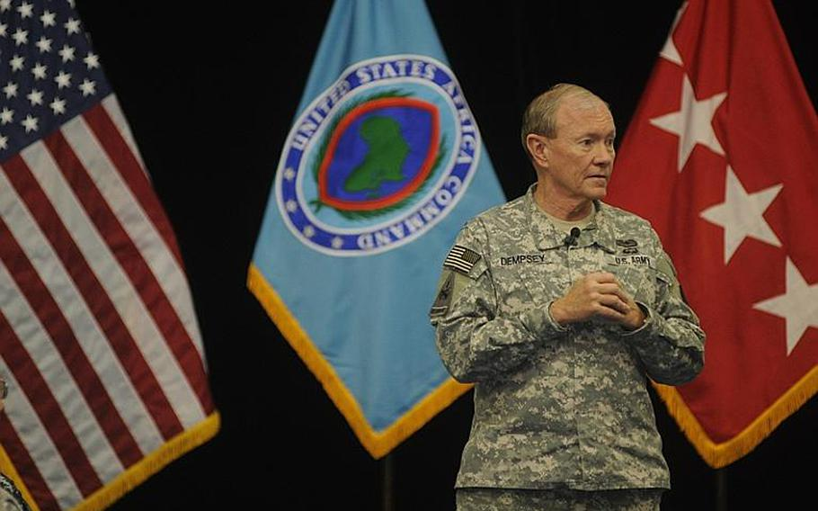 U.S. Army Gen. Martin Dempsey, chairman of the Joint Chiefs of Staff, answers questions at a Monday town hall with members of U.S. Africa Command on Kelley Barracks in Stuttgart, Germany. Dempsey visited as part of a holiday tour that also took him to bases in Bahrain and Afghanistan.