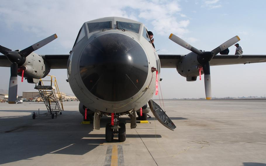 Maintenance workers inspect an Afghan Air Force C-27A Monday at Kabul International Airport. The entire fleet was grounded in December 2011 due to maintenance issues that still haven't been resolved.