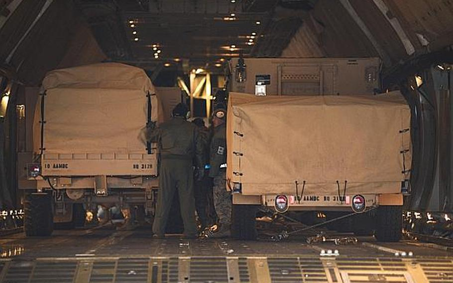 Equipment belonging to the Kaiserslautern-based 10th Army Air and Missile Defense Command is loaded onto a C-5 Galaxy at Ramstein Air Base, Germany, on Tuesday, Jan. 8, 2013.