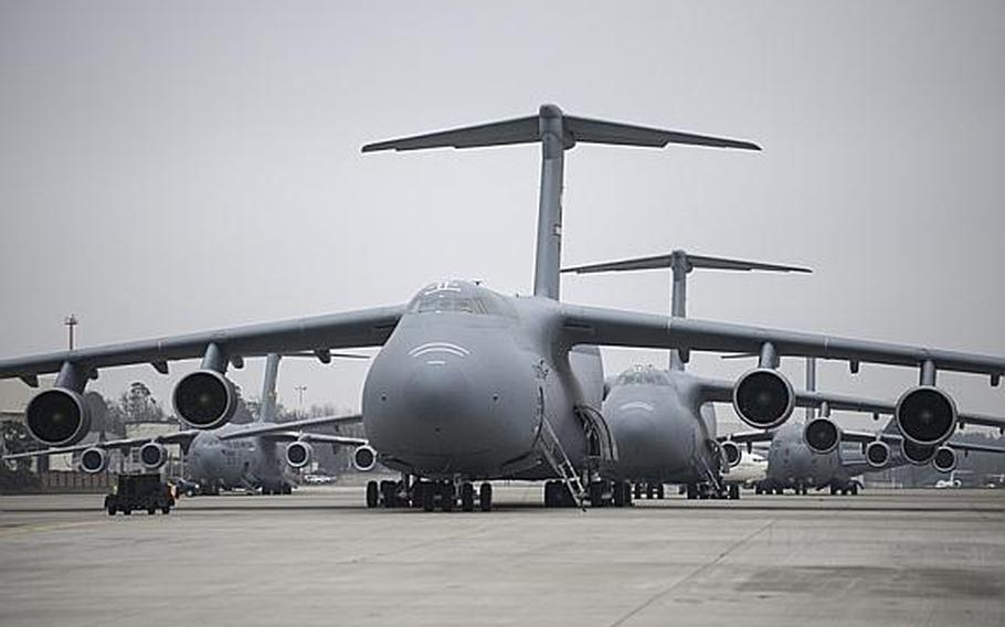 C-5 Galaxy aircraft line up on the flight line of Ramstein Air Base, Germany, as U.S. troops who will serve as the command-and-control element for U.S. Patriot missile batteries deploying to Turkey were delayed for a second day due to plane issues, on Tuesday, Jan. 8, 2013.