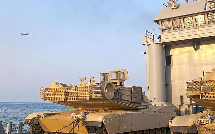 420th Movement Control Battalion's vessel, Landing Craft Utility (LCU) 2018, Five Forks, and its cargo, two M1A2 Abrams main battle tanks during a communication and integration exercise in the Persian Gulf, Oct. 24.