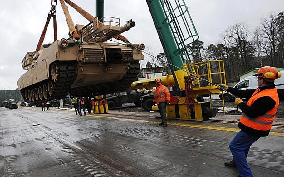 German railway loadmasters with the Theater Logistics Support Center Europe help load an Abrams main battle tank at the railhead in Kaisersalutern. The tank was one of 22 bound for South Carolina, marking the end of an Army tank presence in Germany.