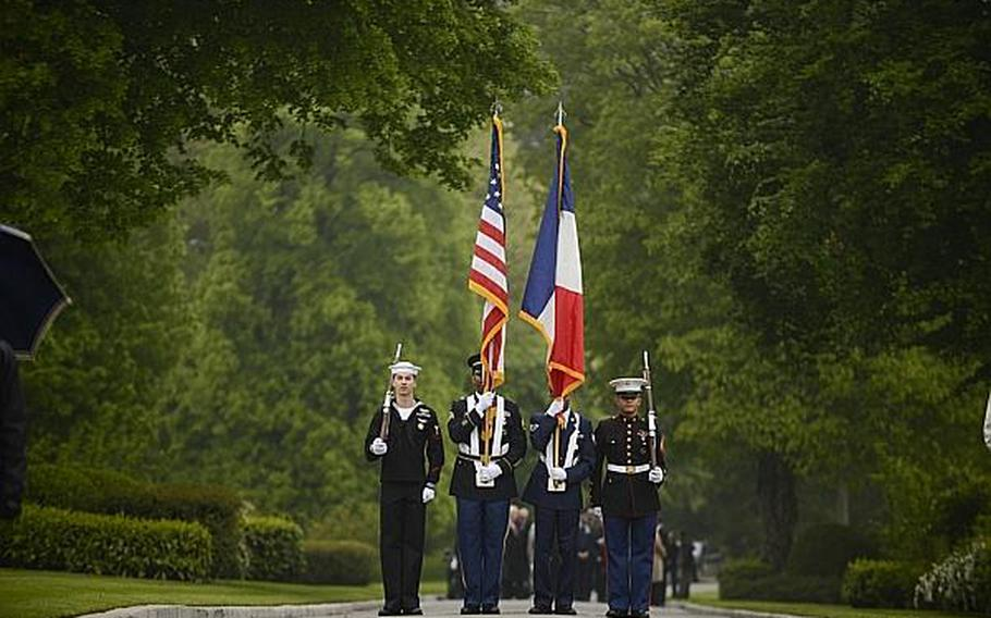 A Color Guard comprised of all four U.S. services prepares to present the colors Sunday morning during an American Memorial Day ceremony at the Meuse-Argonne American Cemetery and Memorial in France.  Joshua L. DeMotts/Stars and Stripes