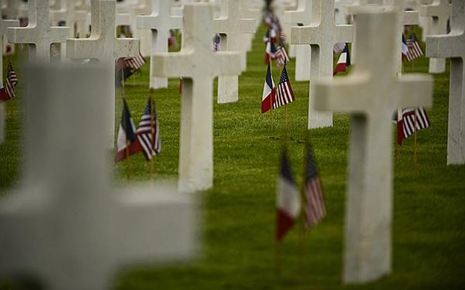 U.S. and French flags are planted next to headstones of the more than 14,000 American servicemembers who lost their lives in the Meuse-Argonne Offensive of World War I. An American Memorial Day ceremony was held Sunday at the Meuse-Argonne American Cemetery and Memorial in France.  Joshua L. DeMotts/Stars and Stripes