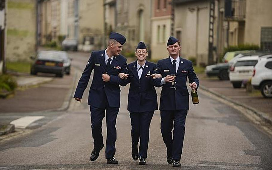 From left to right, U.S. Air Force Senior Airman Aaron Dickerson, Airman 1st Class Bonnie Burks, Airman 1st Class Josiah Austin, from Ramstein Air Base, Germany, walk to their bus after a French-hosted reception that followed an American Memorial Day Ceremony at the Meuse-Argonne American Cemetery and Memorial in France. A large group of Airmen from Ramstein volunteered to participate in the ceremony held Sunday morning.  Joshua L. DeMotts/Stars and Stripes