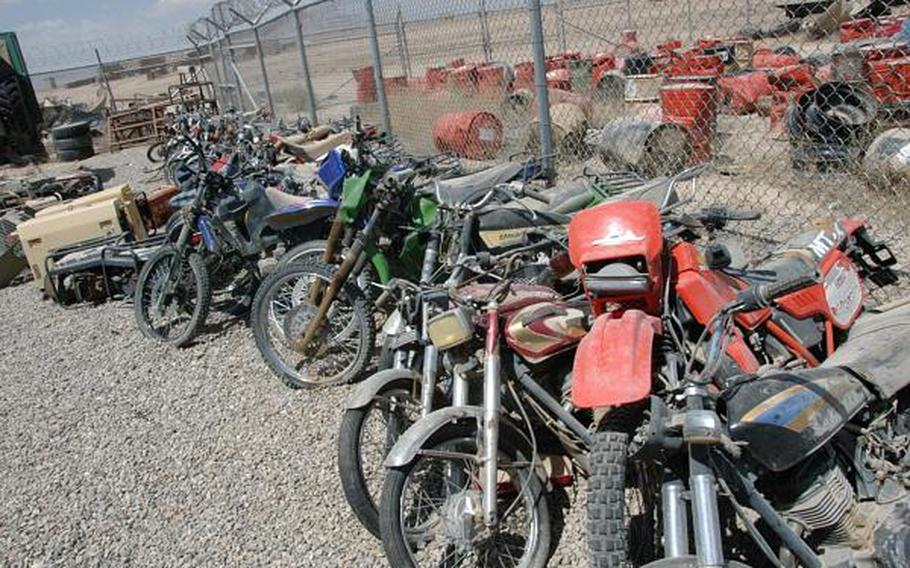 Confiscated Taliban motorcycles rust in a yard at Forward Operating Base Apache, Zabul Province, Afghanistan. While the Taliban has relied on motorcycles to carry out the attacks, few coalition armies are using the lighter, faster vehicles.