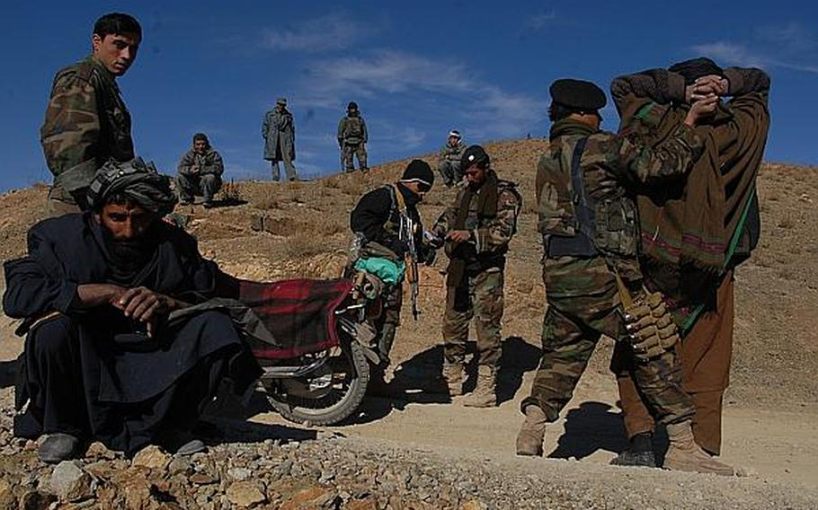 Afghan soldiers search a pair of motorcycle riding suspected insurgents in Zabul Province in December 2007.  While the Taliban has relied on motorcycles to carry out the attacks, few coalition armies are using the lighter, faster vehicles.