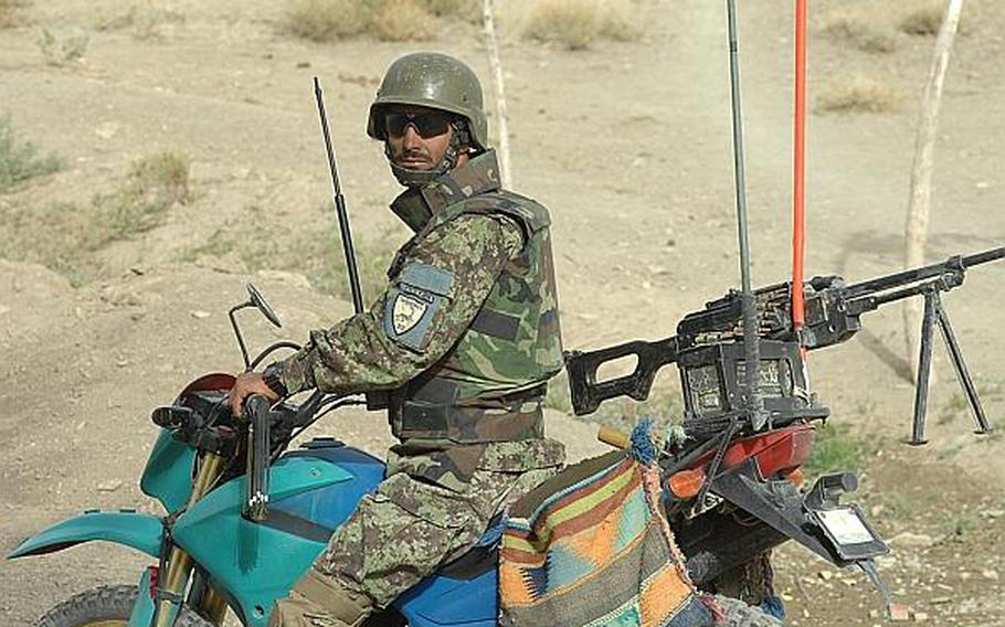 An Afghan soldier rides a motorcycle during a patrol in Zabul Province in 2010. While the Taliban has relied on motorcycles to carry out the attacks, few coalition armies are using the lighter, faster vehicles.