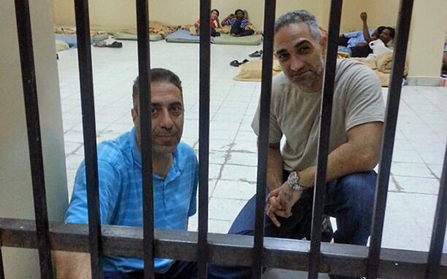 Arabic linguists Maher Al Masri, left, and Ramzi Zinnekah wait inside a Kuwaiti jail cell in a photo Zinnekah said was taken by a guard. The two men, U.S. civilians employed by defense contractor Global Linguist Solutions, were detained by local authorities in late May and deported to the U.S. as part of a dispute between GLS and the Kuwaiti company it hired to manage its employees. Both are now back at their homes in the States.