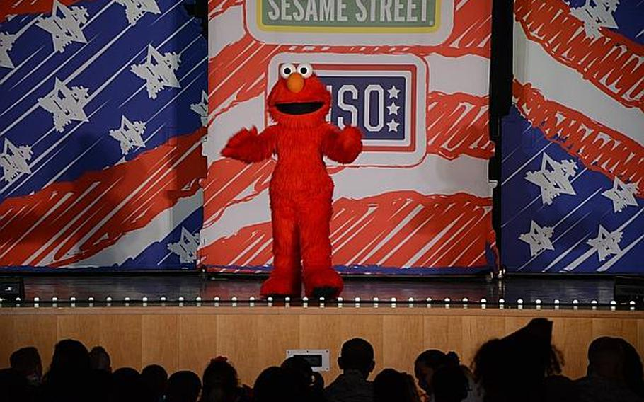 """Elmo greets an audience full of children, parents and servicemembers during a """"Sesame Street"""" show at Aviano Air Base, Italy, on Friday, July 5, 2013. """"Sesame Street,"""" in conjunction with the United Service Organizations, is traveling across the Pacific and Europe during the summer.  Jason Duhr/Stars and Stripes"""