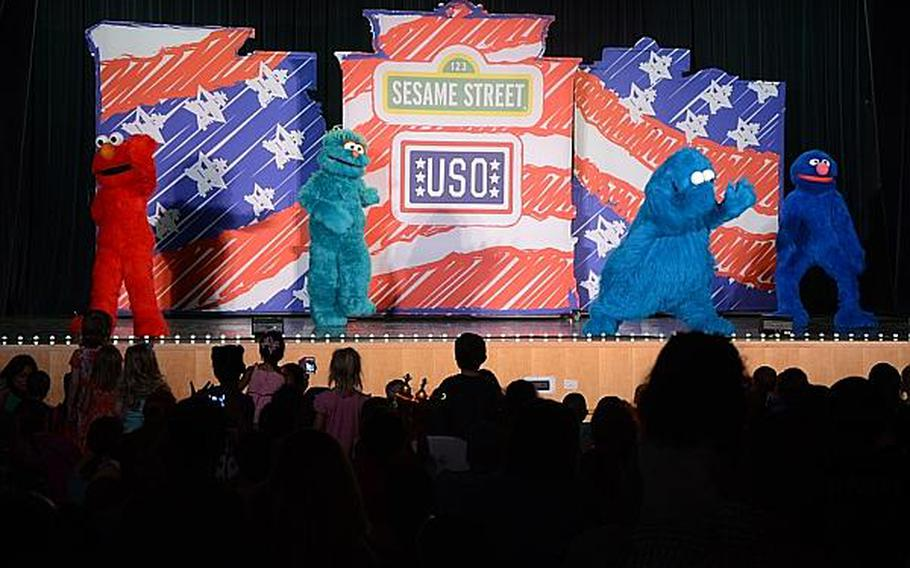 """Elmo, Rosita, Cookie Monster and Grover take the stage during a """"Sesame Street"""" show at Aviano Air Base, Italy, on Friday, July 5, 2013.  Jason Duhr/Stars and Stripes"""