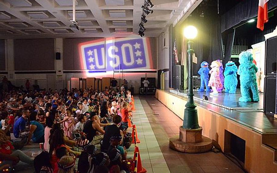 """Characters from """"Sesame Street"""" entertain the audience during during a show Friday, July 5, 2013 at Aviano Air Base, Italy. """"Sesame Street,"""" in conjunction with the United Service Organizations, is traveling across the Pacific and Europe during the summer.  Jason Duhr/Stars and Stripes"""