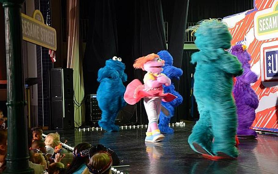 """Children crowd the stage as """"Sesame Street"""" characters dance and sing at a show Friday, July 5, 2013 at Aviano Air Base, Italy.  Jason Duhr/Stars and Stripes"""