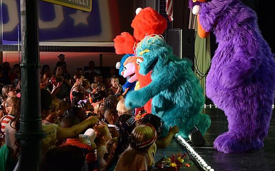 """""""Sesame Street"""" characters greet children during a show Friday, July 5, 2013, at Aviano Air Base, Italy.  Jason Duhr/Stars and Stripes"""